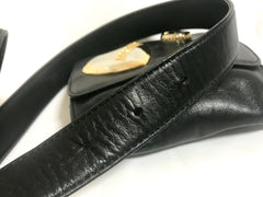 Vintage MOSCHINO black leather waist purse, fanny pack, clutch bag with large golden heart and key motifs. So chic and mod.