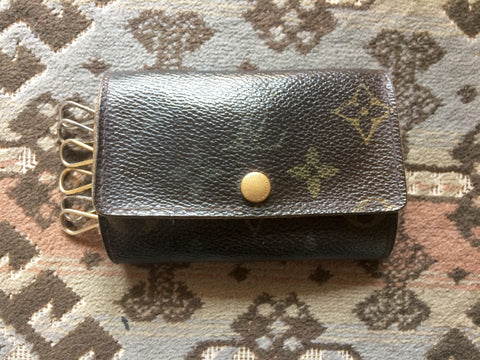 Vintage Louis Vuitton brown monogram key case. Classic unisex wallet from the old era.