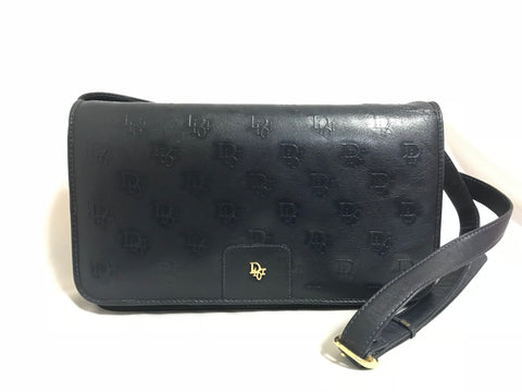 MINT. Vintage Christian Dior navy leather clutch purse, shoulder bag with golden Dior logo motif.