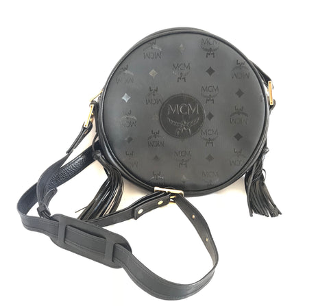 Vintage MCM black monogram round shape Suzy Wong shoulder bag with leather trimmings and fringes. Unisex bag