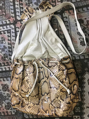 Vintage Carlos Falchi beige and brown combo snakeskin large messenger style shoulder bag in unique round form. Hold lots of things.