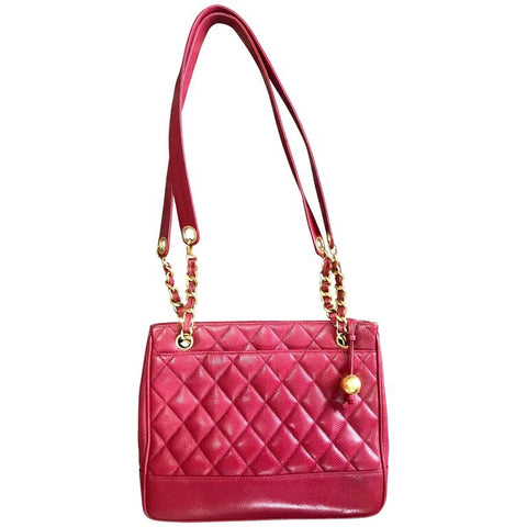 Vintage CHANEL cherry red caviar leather quilted shoulder bag, tote with golden CC ball and chain straps. Classic bag.