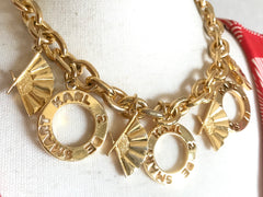 Vintage Karl Lagerfeld golden chain statement necklace with logo and fan dangle charms. Gorgeous rare jewelry piece back in the era.