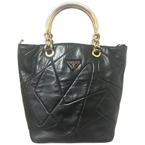 Vintage Prada black leather geometric patchwork tote bag, handbag with metallic hardware handles.  So chic and mod. Unique and rare bag.