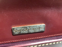 Vintage Cartier wine leather clutch bag, mini document purse with logo motif. Unisex bag from must de Cartier Collection.