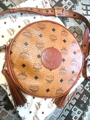 Vintage MCM brown monogram round Suzy Wong shoulder bag with brown leather trimmings. Designed by Michael Cromer. Classic bag. German made.
