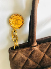 Vintage CHANEL brown suede classic tote bag with large CC mark and golden CC medal charm to the zipper. Classic purse for daily use.