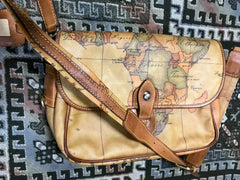 Vintage Alviero Martini  Prima Classe messenger type classic shoulder bag with a map print of Africa and Southeast Asia. Unisex use.