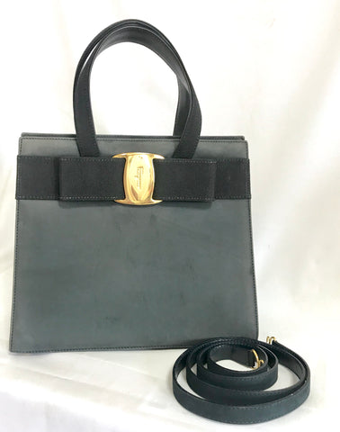 Vintage Salvatore Ferragamo navy gray suede leather handbag with gold tone vara charm with embossed logo and shoulder strap.
