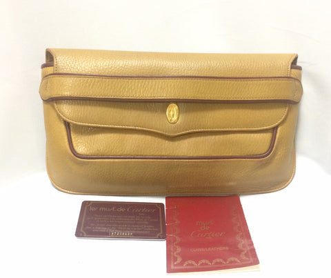 Vintage Cartier leather in yellow mustard color clutch with gold tone charm. must de Cartier Collection