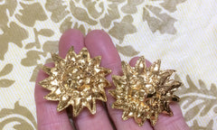 MINT. Vintage CHANEL rare lion design golden earrings with CC marks around lion face.