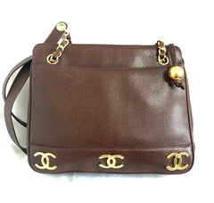 Vintage CHANEL brown caviar leather chain shoulder bag with 3 golden CC marks on both sides. Classic purse.
