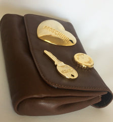 Vintage MOSCHINO chocolate brown leather waist purse, fanny bag, clutch bag with large golden heart and key motifs. So chic and mod