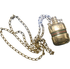 Vintage Gucci gold tone mini perfume, eau de cologne bottle necklace with embossed logo mark and webbing sherry line. Gorgeous jewelry.