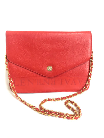 Vintage Valentino Garavani red leather chain shoulder bag with rose flower embossed design and round V motif. Can be clutch bag.