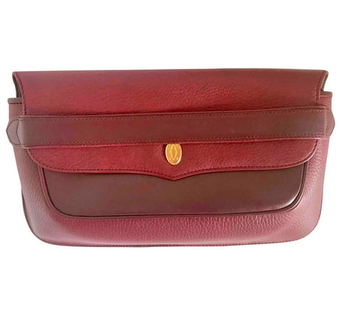 Vintage Cartier wine leather clutch bag with gold tone logo motif. Classic purse from must de Cartier Collection.