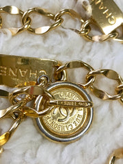 Vintage CHANEL golden thick chain belt with logo engraved bar motifs and a round charm to the end. Must have gorgeous accessory.