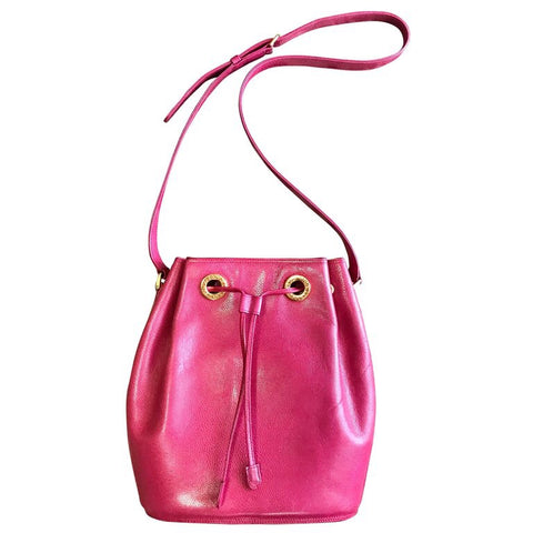 Vintage Valentino Garavani pink caviarskin type leather hobo bucket shoulder bag with round logo motifs and drawstrings.