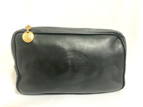 Vintage Gianni Versace black leather purse pouch, case bag with its iconic medusa face and golden logo motif charm. Unisex bag.
