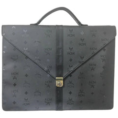 Vintage MCM black monogram briefcase, business bag, document purse with leather handle. Great masterpiece by Michael Cromer