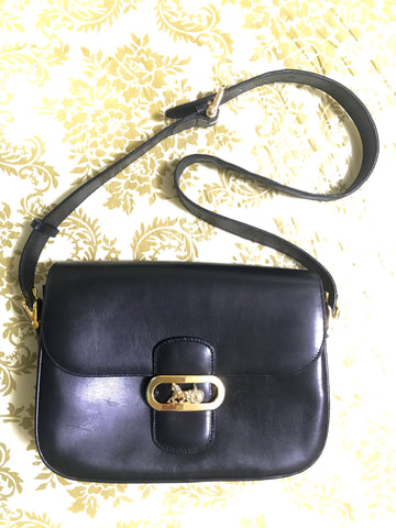 Vintage Celine black leather shoulder bag with golden logo and carriage closure. Elegant and classic purse. Must have daily use piece.