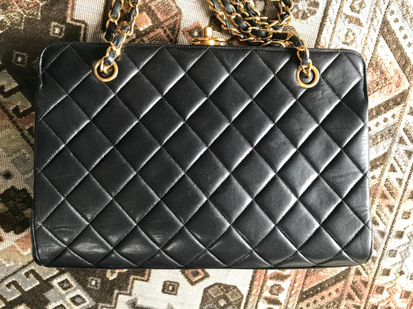b011826bd344 Rare Vintage CHANEL black lambskin golden chain shoulder bag with golden CC  kiss lock closure.