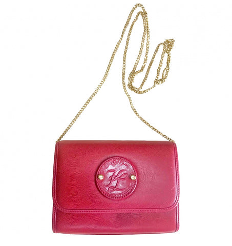 Vintage Karl Lagerfeld mini red clutch shoulder bag with round logo motif. Rare and beautiful purse.