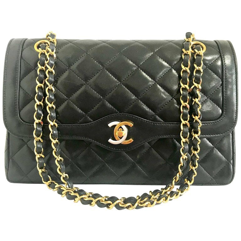 251872fb4bd4 Vintage Chanel black 2.55 classic double flap bag with gold and silver CC  motif and chains