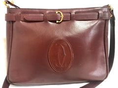 Vintage Cartier kelly style wine leather shoulder bag with a decorative built-in belt.  les must de cartier collection.