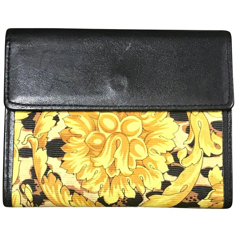 c750e45250a Vintage Gianni Versace black leather card case wallet with its iconic  yellow and golden Edwardian arabesque
