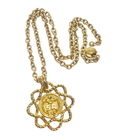 Vintage Sonia Rykiel long golden chain necklace with twisted flower and logo pendant top. Perfect vintage jewelry from SR.