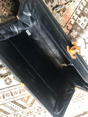 Vintage CHANEL black lambskin golden chain shoulder bag with golden CC kiss lock closure. Rare medium clutch type 2.55 but classic purse.