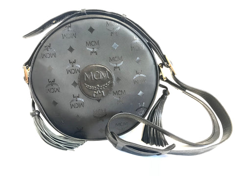 Vintage MCM black monogram round shape Suzy Wong shoulder bag with leather trimmings and fringes. Unisex rare bag.