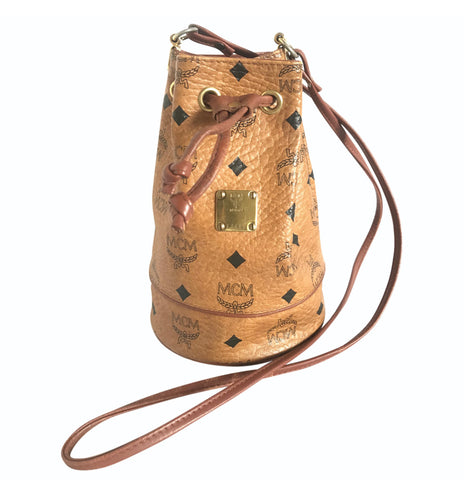 Vintage MCM brown monogram small hobo bucket bag with golden plate. mini purse. Made in Germany. Designed by Michael Cromer.