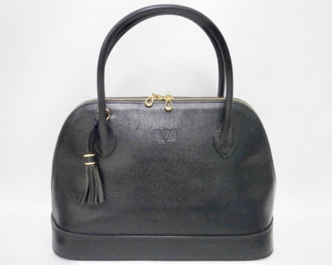 Vintage Valentino Garavani black leather bolide bag with shoulder strap, V logo, a fringe. Classic dialy use purse.