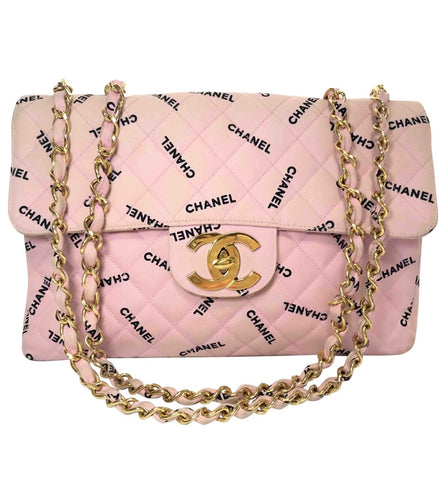 Vintage CHANEL pink canvas classic 2.55 jumbo purse with black CHANEL logo print all over. Rare masterpiece large bag.