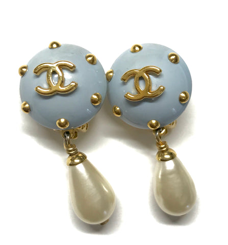 Vintage CHANEL white teardrop faux pearl dangle earrings with blue and golden CC mark and studs on top. Must have jewelry.