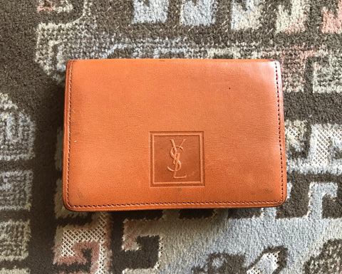 Vintage Yves Saint Laurent brown and khaki leather coin wallet with YSL logo embossed motif at front.