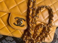 Vintage Chanel classic 2.55 rare yellow color soft lamb leather chain shoulder bag with golden CC closure. Good fortune color.