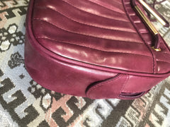 Vintage FENDI wine red lambskin leather shoulder bag with golden logo charm pull. Vertical stitch. Rare masterpiece purse