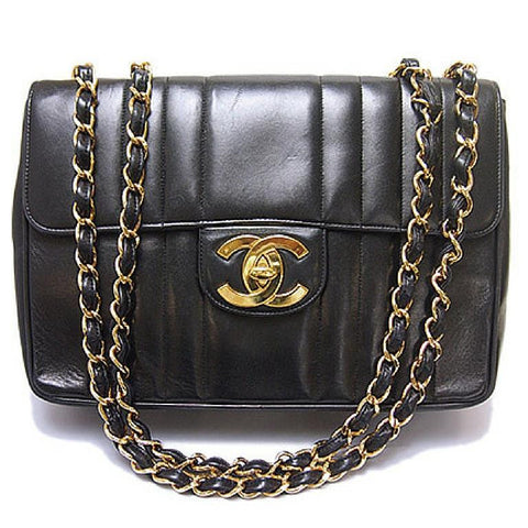 Vintage CHANEL black lambskin 2.55 classic jumbo, large chain, large shoulder bag with golden CC. Vertical stitch.
