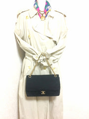 70's vintage Chanel classic black jersey 2.55 bag with double flap and skinny chain straps. One-of-a-kind bag.
