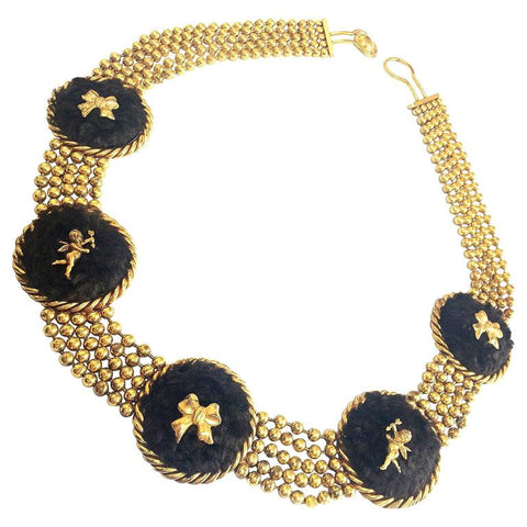 Vintage Karl Lagerfeld golden ball chain belt, necklace with extra large round charms in genuine brown sheep fur, angel, and bow motifs.