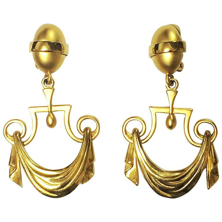 Vintage Karl Lagerfeld golden dangling earrings in drapery window curtain design. Unique and rare jewelry.