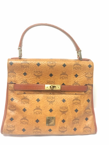 Vintage MCM Kelly style bag with golden logo plate in classic brown monogram. Perfect daily use bag.