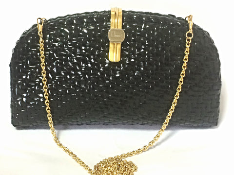 Vintage LANCEL, black bamboo woven clutch bag in round oval shape with chain strap. Unique piece you must have for summer.