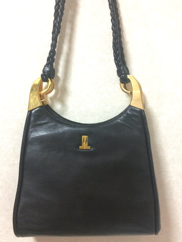 Vintage LANVIN black leather trapezoid shape shoulder bag with kiss lock closure and snail design brass and braided straps. Masterpiece.