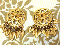 Vintage CHANEL round arabesque CC design golden earrings with dangling mini leaf motifs. Rare jewelry. Perfect gift.