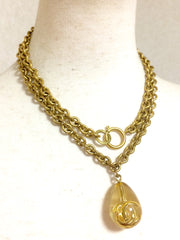 Vintage CHANEL long chain necklace with clear plastic teardrop pendant top with golden 3D CC logo. Perfect CHANEL accessory.