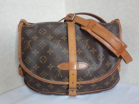 SOLD OUT: Vintage Louis Vuitton monogram saumur messenger shoulder bag with leather trimmings. Great vintage condition and daily bag for unisex